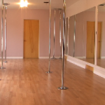 studio with pole dancing poles for fitness