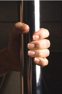 hand gripping pole