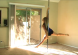 women pole dancing at home on a portable dance pole