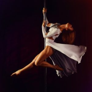 artistic pole dance on a dance pole