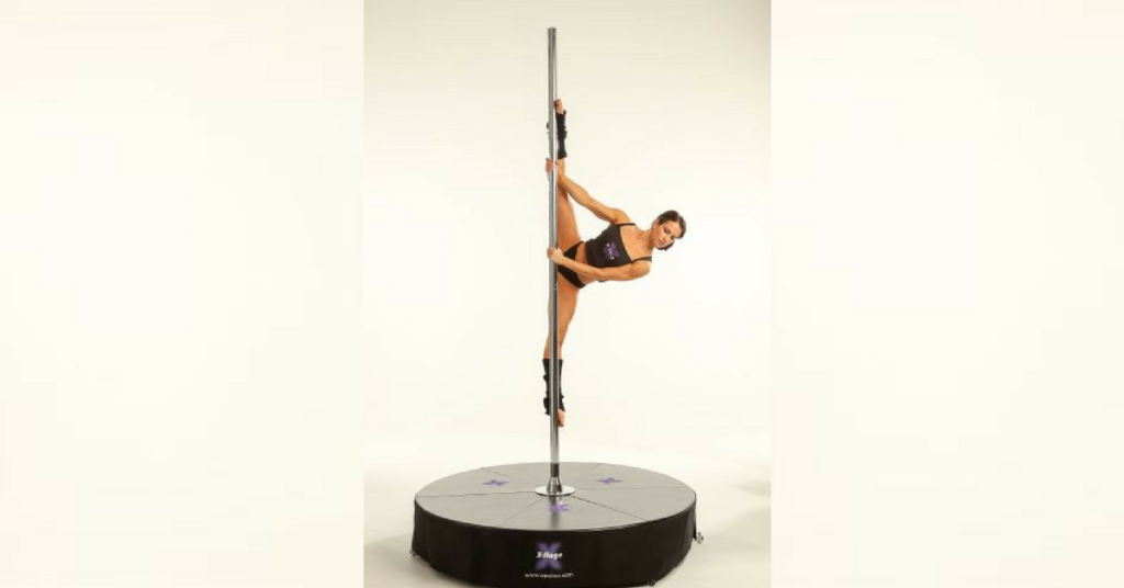 Girl doing pole tricks on an XStage Standard Stand Alone Dance Pole Kit