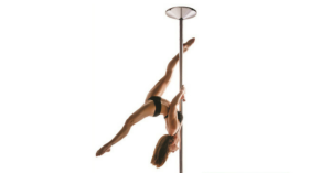 woman practicing on a spinning dance pole
