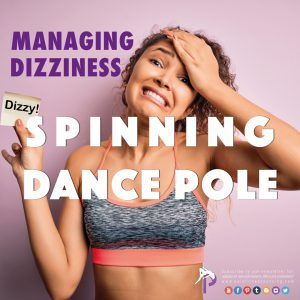 a girl holding her head cause she is feeling dizzy after spinning on pole dance