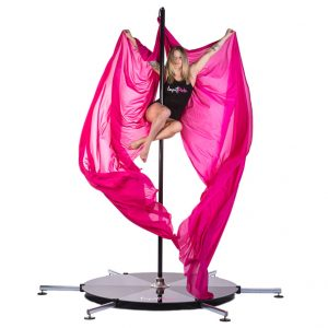 A woman practicing on her lupit stage with silks attached.