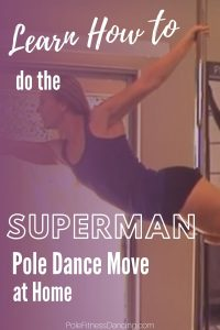 A woman doing the superman pole dance move on a pole at her home.