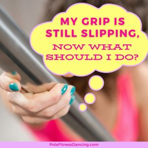A woman's grip is still slipping on dance pole, sweaty hands while pole dancing solution