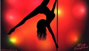 A woman demonstrating a pole move on a at home dance pole