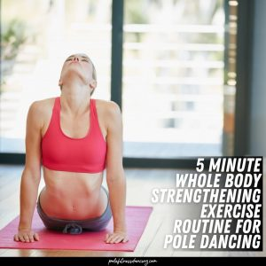 A woman exercising before her pole dance routine