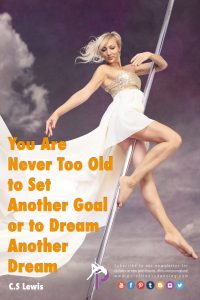 a female in a white dress hanging from a stage pole and doing her Pole Dancing Fitness Beginners Tutorials